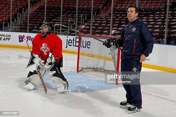 ESPNs Linda Cohn stands in front of the net while Florida Panthers Goaltending Coach Robb Tallas gives directions during the Goal of a Lifetime...