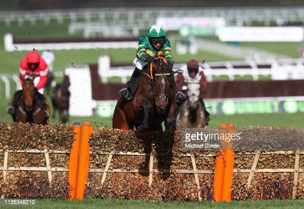 Espoir D'Allen ridden by Mark Walsh clears the final fence during the Unibet Champion Hurdle Challenge Trophy on Champion Day of the Cheltenham...