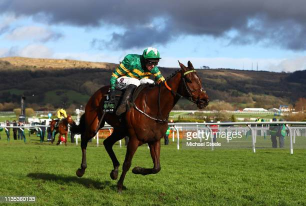 Espoir D'Allen ridden by Mark Walsh races to victory during the Unibet Champion Hurdle Challenge Trophy on Champion Day of the Cheltenham Festival at...