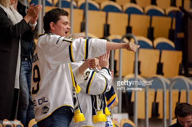Espoo Blues supporter celebrate after the game during the Champions Hockey League round of eight game between HV71 Jonkoping and Espoo Blues on...