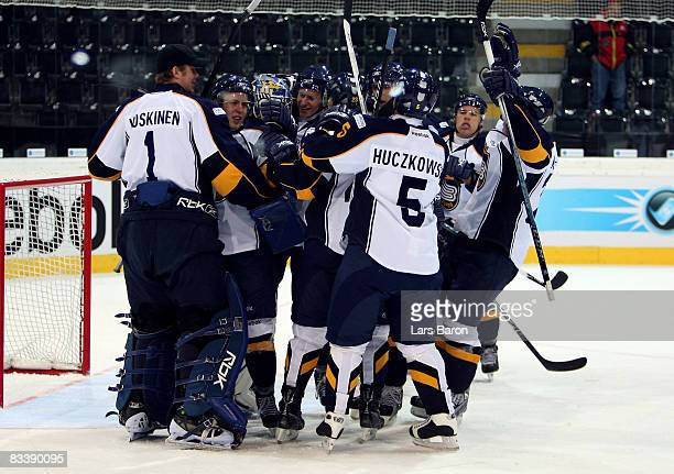 Espoo players celebrate after winning the IIHF Champions Hockey League match between SC Bern and Espoo Blues at the PostFinance Arena on October 22,...