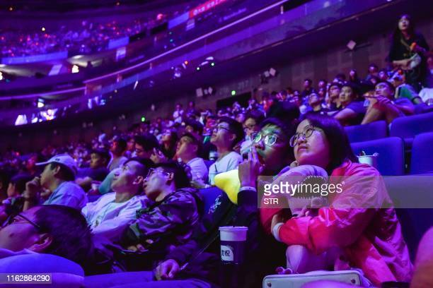 ESports fans look on during the International Dota 2 Championships in Shanghai on August 20 2019 A record 335 million USD is up for grabs but...