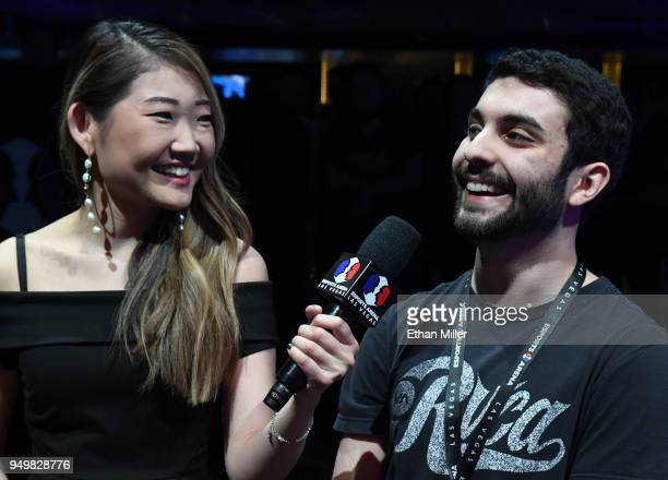 Esports host Sue Lee interviews gamer Maurilio 'Blind' Gramajo of California after he won his second straight match of 'Fortnite' while playing...