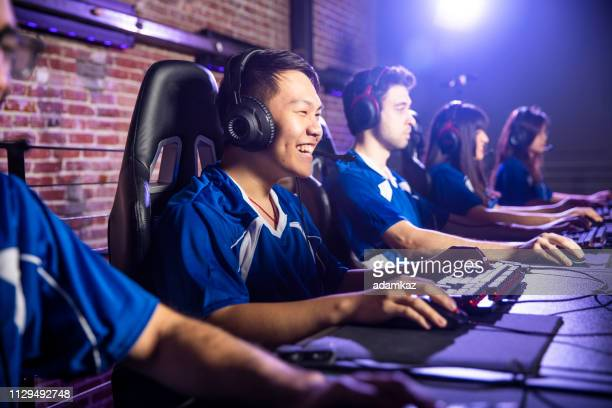 esports team playing in a tournament - esport stock pictures, royalty-free photos & images