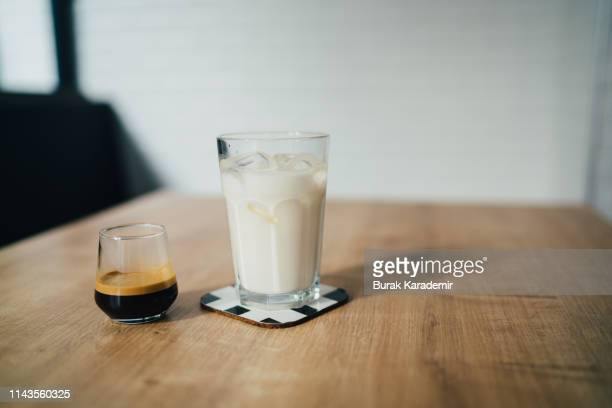 espresso and milk next to each other - koffie drank stockfoto's en -beelden