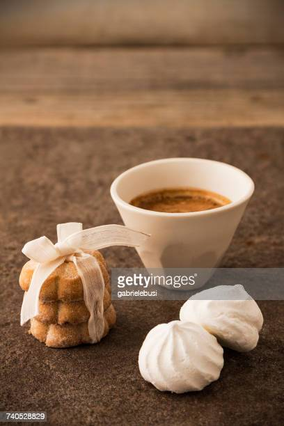 Espresso coffee and a stack of cookies with meringues