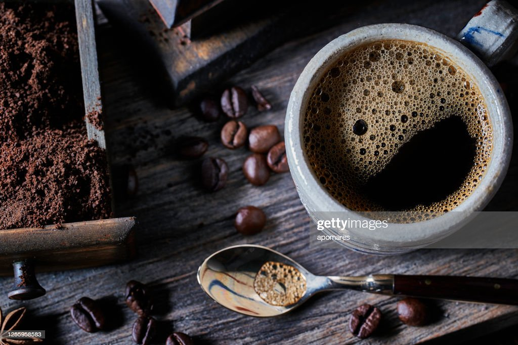 Espresso coffee cup on vintage table with ground and roasted coffee beans : Stock Photo