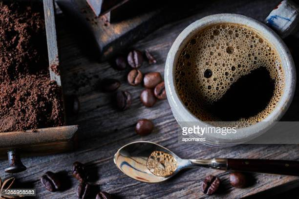 espresso coffee cup on vintage table with ground and roasted coffee beans - caffeine stock pictures, royalty-free photos & images