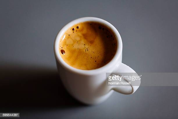 Espresso coffee in cup on gray background