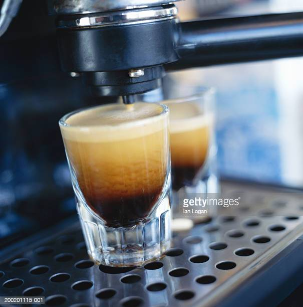 Espresso coffee machine with two single shots