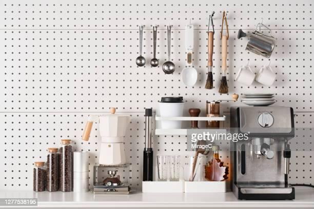 espresso coffee maker and accessories on pegboard - kitchen utensil stock pictures, royalty-free photos & images