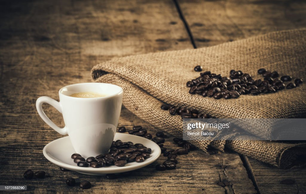 Espresso coffee on an old wooden table : Stock Photo