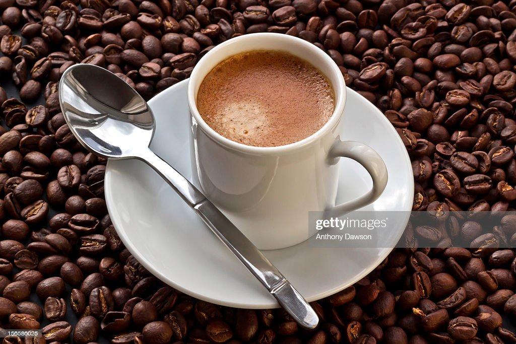 Espresso coffee on coffee beans : Stock Photo