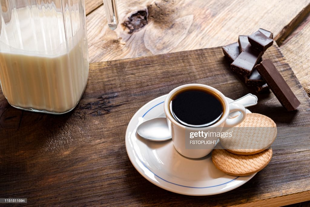 Espresso coffee with cookies on rustic pine wood table : Stock Photo