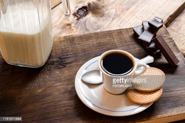 Espresso coffee with cookies on rustic pine wood table