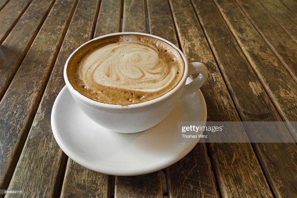 Espresso Macchiato on a worn wooden table : Stock Photo
