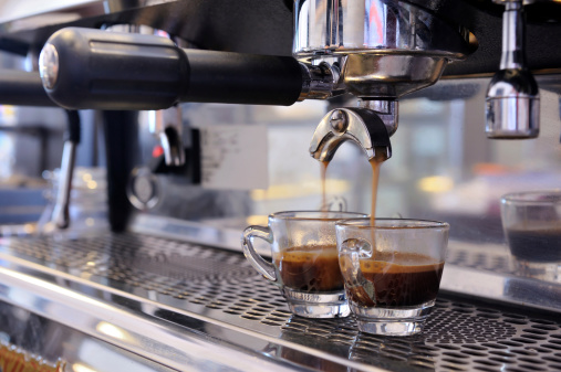 Espresso machine filling two cups of coffee 450509011