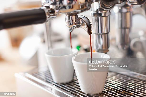 Espresso machine pouring cups of coffee