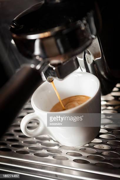 Espresso machine pouring into white cup