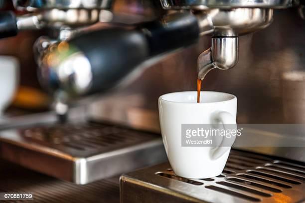 Espresso machine preparing cup of espresso