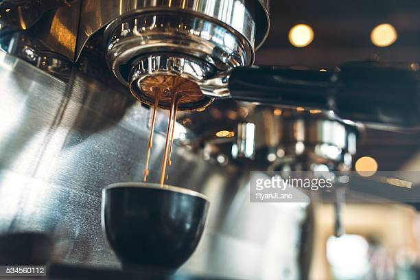 espresso machine pulling a shot - espresso stock photos and pictures