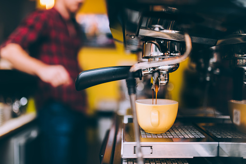 Espresso machinery pouring freshly brewed coffee in cafe shop. barista details and bartender 956490722