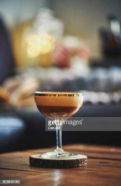 Espresso martini cocktail on coffee table in indoor setting