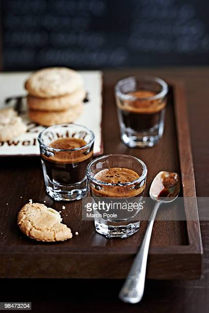 espresso on wooden tray in cafe