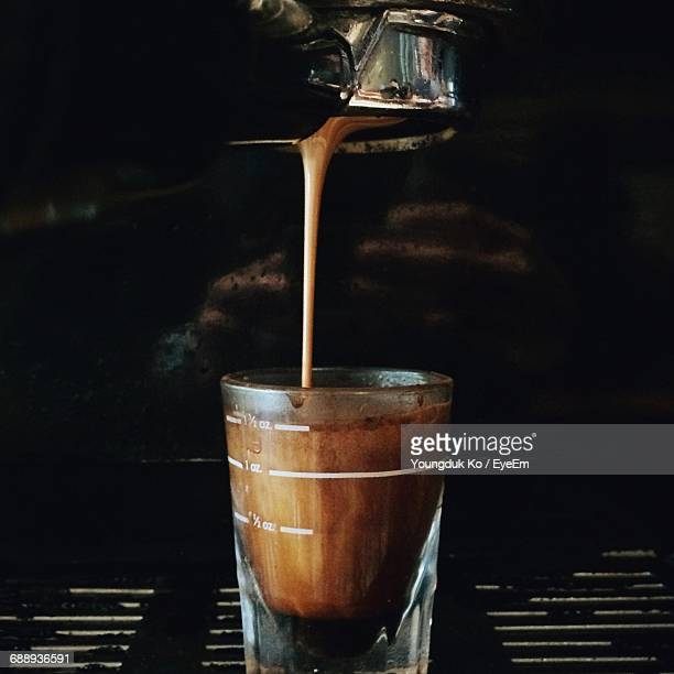 Espresso Pouring From Coffee Maker Into Cup