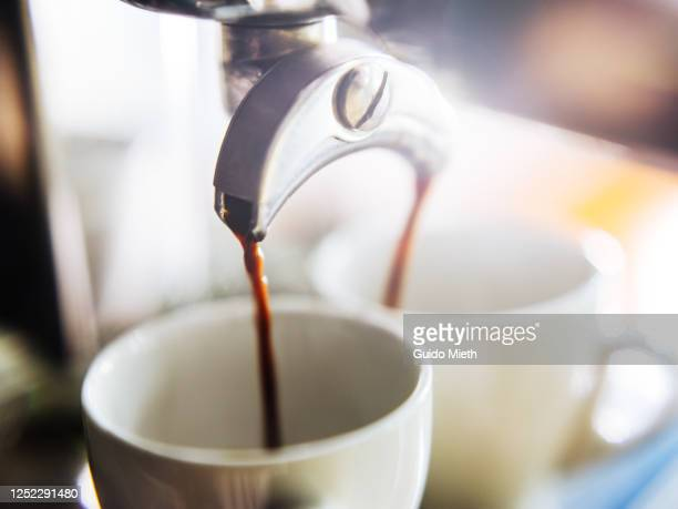 espresso shot for two pouring out. - guido mieth stock pictures, royalty-free photos & images