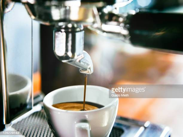 espresso shot pouring out. - guido mieth stock pictures, royalty-free photos & images