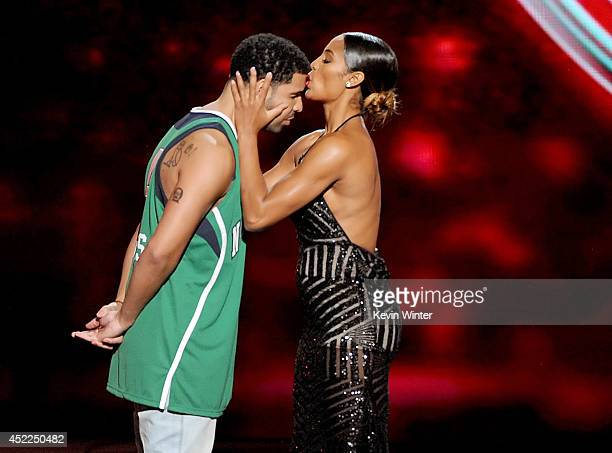 ESPYs host Drake with WNBA player Skylar Diggins onstage during the 2014 ESPYS at Nokia Theatre L.A. Live on July 16, 2014 in Los Angeles, California.