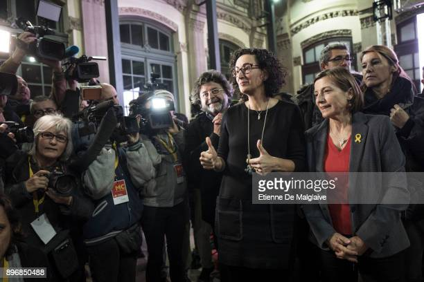 Esquerra Republicana de Catalunya' ERC candidate Marta Rovira and Carme Forcadell former Parliament president as they went to salute a small crowd of...