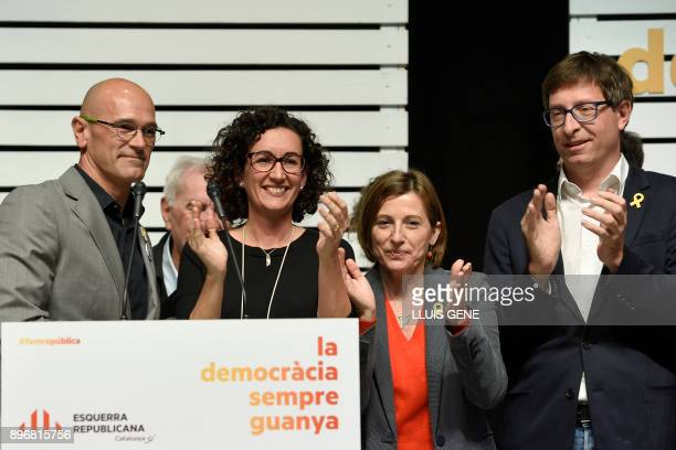 'Esquerra Republicana de Catalunya' ERC candidates Marta Rovira Raul Romeva Carme Forcadell and Carles Mundo applaud after giving a press conference...