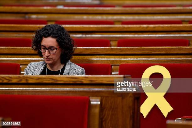 'Esquerra Republicana de Catalunya' ERC member Marta Rovira sits next to a yellow ribbon placed at on an empty seat reserved for deposed Catalan...