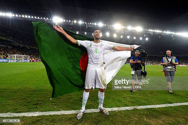 Essaid Belkalem of Algeria celebrates qualifying for the knock out stage after the 11 draw in the 2014 FIFA World Cup Brazil Group H match between...