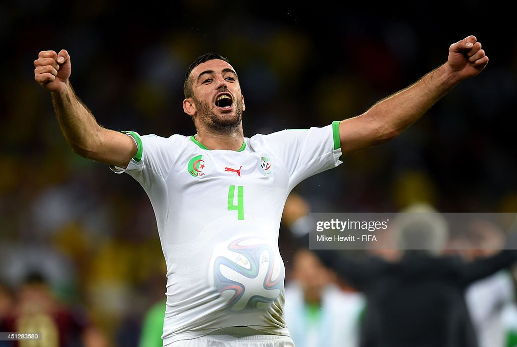 Essaid Belkalem of Algeria celebrates qualifying for the knock out stage after the 1-1 draw in the 2014 FIFA World Cup Brazil Group H match between Algeria and Russia at Arena da Baixada on June 26, 2014 in Curitiba, Brazil.