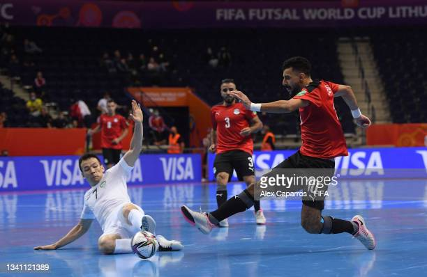 Essam Alla of Egypt and Dilshod Rakhmatov of Uzbekistan challenge for the ball during the FIFA Futsal World Cup 2021 group B match between Egypt and...