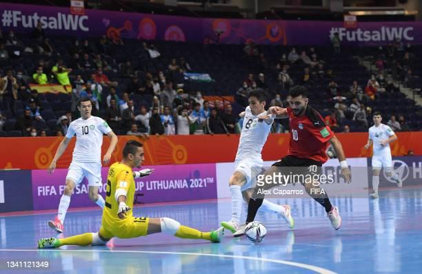 Essam Alla of Egypt challenges for the ball with Khusniddin Nishonov of Uzbekistan and Elibaev Ravshan of Uzbekistan during the FIFA Futsal World Cup...