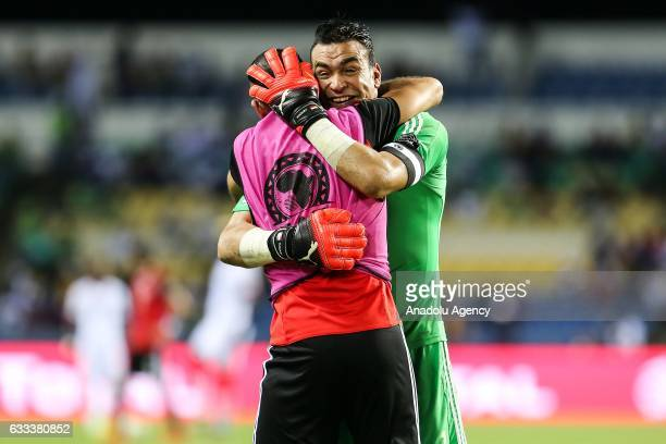 Essam El Hadary of Egypt hugs his teammate Mohamed Salah after scoring a goal during the 2017 Africa Cup of Nations semifinal football match between...