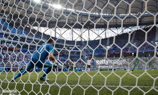Essam El Hadary of Egypt saves a penalty from Fahad Almuwallad of Saudi Arabia during the 2018 FIFA World Cup Russia group A match between Saudia...