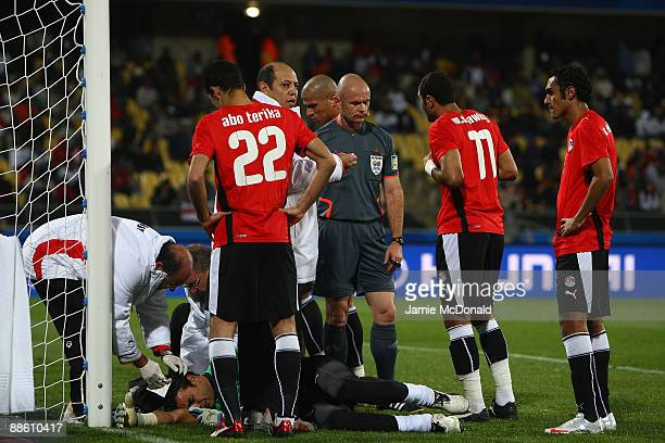 Essam El Hadary of Egypt takes a blow to the head during the FIFA Confederations Cup match between Egypt and USA at Royal Bafokeng Stadium on June 21...