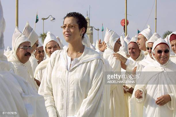 Essauira Mayor Asma Chaabi Morocco's only female mayor and a regional delegate participates in a ceremony at the royal palace of Rabat 31 July 2004...