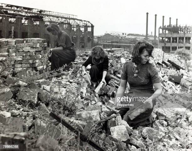 Essen, West Germany Three girls of Essen help to clear the rubble caused by fighting in World War Two