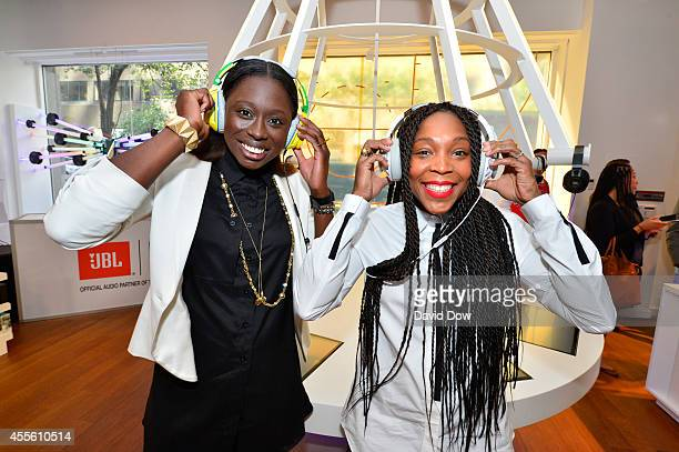Essence Carson and Cappie Pondexter of the New York Liberty wear headphones during a Press Conference to announce HARMAN will become the official...