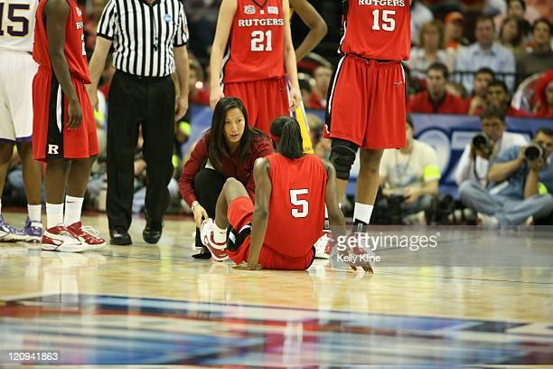 Essence Carson goes down with an injury during the semifinal of the NCAA Women's basketball tournament at Quicken Loans Arena in Cleveland Ohio on...