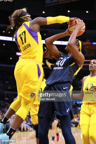 Essence Carson of the Los Angeles Sparks blocks the shot of Kayla Alexander of the Indiana Fever during a WNBA basketball game at Staples Center on...