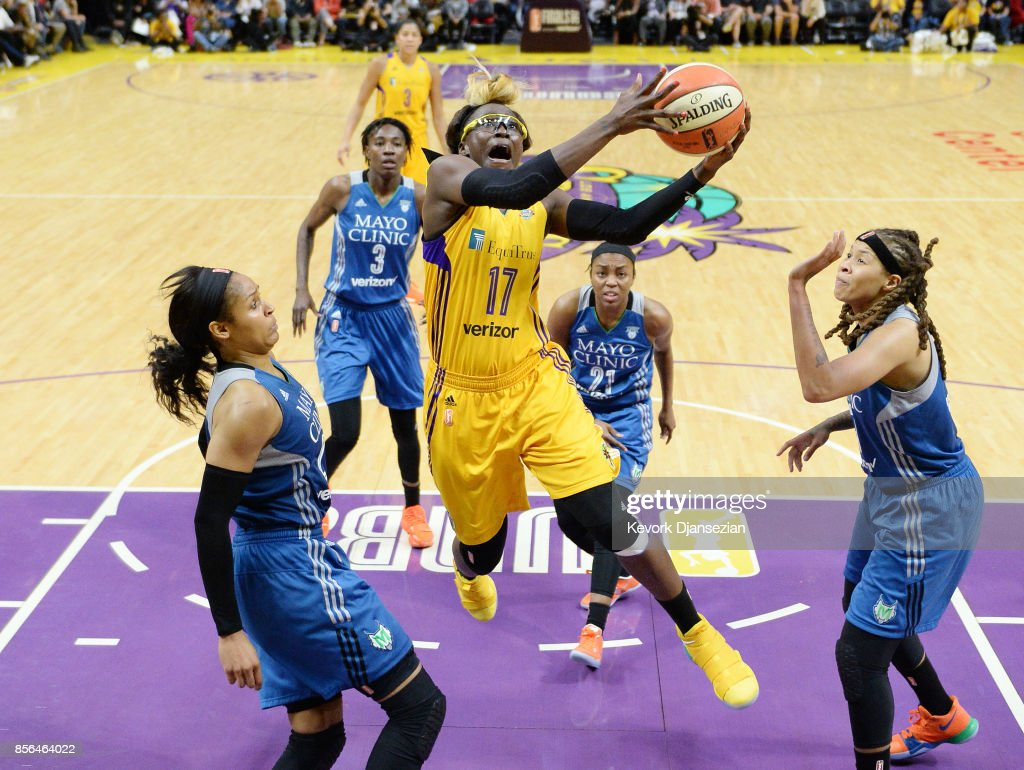 Essence Carson #17 of the Los Angeles Sparks drives to the basket to score against Maya Moore #23 Renee Montgomery #21 and Seimone Augustus #33 of the Minnesota Lynx during the second half of Game Four of WNBA Finals at Staples Center October 1, 2017, in Los Angeles, California.