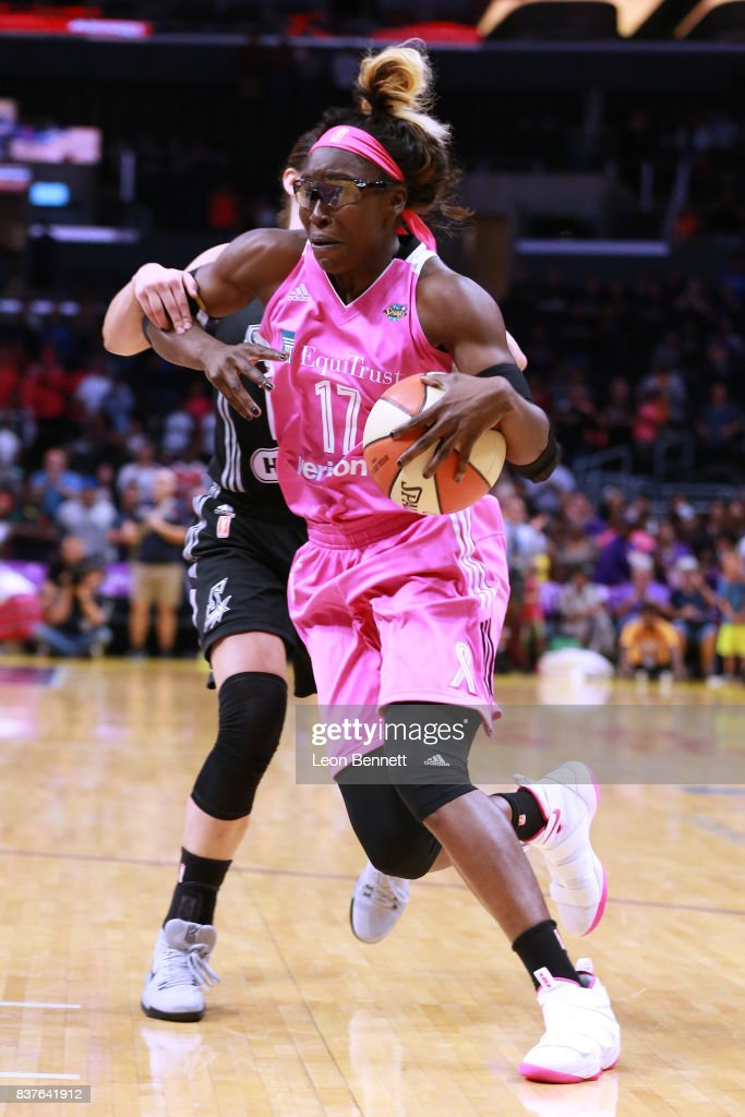 Essence Carson #17 of the Los Angeles Sparks handles the ball against Kelsey Plum #10 of the San Antonio Stars during a WNBA game at Staples Center on August 22, 2017 in Los Angeles, California.