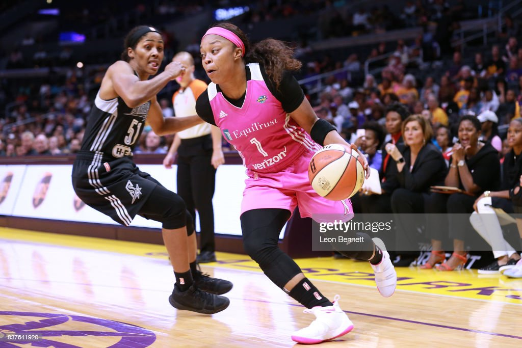 Essence Carson #17 of the Los Angeles Sparks handles the ball against Sydney Colson #51 of the San Antonio Stars during a WNBA game at Staples Center on August 22, 2017 in Los Angeles, California.
